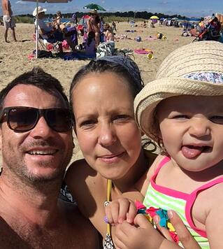 Photo of Anthony, Petra and Lux on the beach
