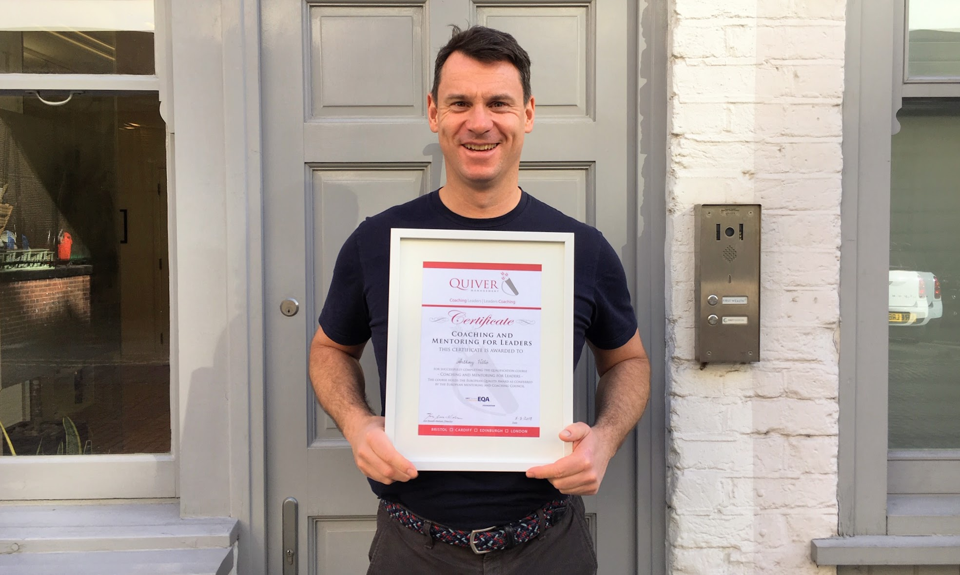 Anthony with his certificate
